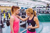 pic of encouraging  - Personal trainer encouraging to sad young woman after a hard training day in the gym - JPG