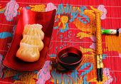 picture of siomai  - steamed shrimp dumplings served on a traditional bamboo place mat - JPG