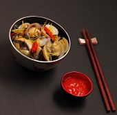 stock photo of clam  - herbal clam soup Vietnam style served on a black background - JPG