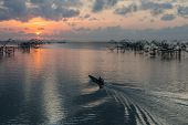 stock photo of fishnet  - Fisher view to commercial use big fishnet in lake - JPG