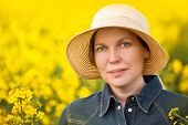 stock photo of cultivation  - Female Farmer Standing and Posing in Oilseed Rapeseed Cultivated Agricultural Field Beauty Portrait - JPG