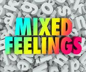 picture of emotion  - Mixed Feelings words in colorful 3d words on a background of jumbled letters in a pile to illustrate complicated - JPG
