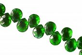 foto of emerald  - String of emerald beads on white background - JPG