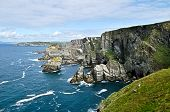 foto of cloudy  - beautiful view of an irish indented shore in a typical cloudy - JPG