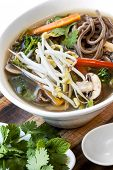 stock photo of cilantro  - Hot and sour vegetable soup with soba noodles and bean sprouts - JPG