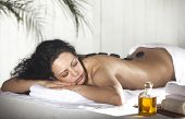 stock photo of black woman spa  - Spa Stone Massage - JPG
