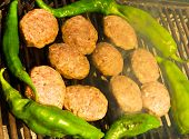 stock photo of meatball  - Fresh grilled meatballs and peppers closeup view