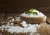 pic of salt-bowl  - Sea salt in bowl and spoon on a wooden background - JPG