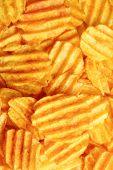 stock photo of potato chips  - Delicious potato chips closeup background - JPG