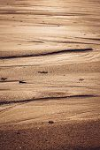 picture of tide  - Natural sand patterns in beach at low tide - JPG
