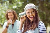 picture of tin man  - Young couple shouting through tin cans on a summers day - JPG