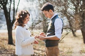 picture of marriage ceremony  - Bride and groom exchanging wedding rings - JPG