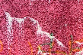 stock photo of hooligan  - Authentic textured background old wall hooligans stained with paint - JPG