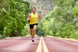 pic of sprinters  - Running man runner sprinting for fitness and health - JPG