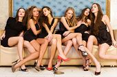 stock photo of night gown  - Group portrait of models in black dresses - JPG