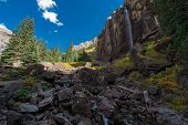 Постер, плакат: Girl Taking Picture Of Bridal Veil Falls Telluride Colorado Usa
