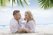 image of love couple  - Portrait of young nice couple having good time on the beach - JPG
