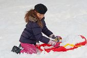 picture of toboggan  - Girl with toboggan in the snow at winter time - JPG