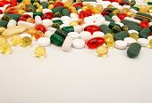 Pills Background. Heap Of Assorted Various Medicine Tablets And Pills Different Colors On White Back poster