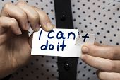 Man Using Scissors To Remove The Word Cant To Read I Can Do It Concept For Self Belief, Positive At poster