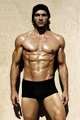 picture of six pack  - Sexy portrait of a very muscular shirtless male model looking away - JPG