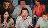 pic of bleachers  - Group of scared people screaming in their seats - JPG