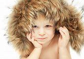 Little boy in a furry hood poster