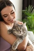 Young Woman With Cute Cat At Home. Pet And Owner poster