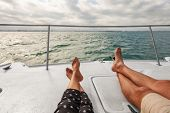 Yacht boat lifestyle couple relaxing on cruise ship in Hawaii holiday . Two tourists feet relax geta poster