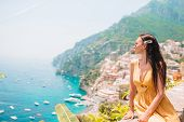 Summer Holiday In Italy. Young Woman In Positano Village On The Background, Amalfi Coast, Italy poster