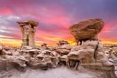 Bisti/De-Na-Zin Wilderness, New Mexico, USA at the Alien Throne rock formation just after sunset. poster