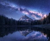 Milky Way Over Antorno Lake At Night. Summer Landscape With Alpine Mountains, Trees, Purple Sky With poster