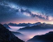 Milky Way Over Mountains In Fog At Night In Summer. Landscape With Foggy Alpine Mountain Valley, Pur poster