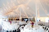 foto of centerpiece  - wedding tables set for fine dining inside a tent