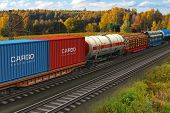 stock photo of boxcar  - Scenic view of mixed freight train within rural landscape - JPG