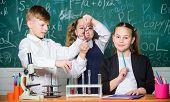 Pupils Study Chemistry In School. Chemical Substance Dissolves In Another. Kids Enjoy Chemical Exper poster