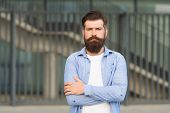 Adding Care To His Mustache. Serious Guy Wearing Beard And Mustache On Urban Background. Bearded Man poster