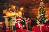 Boy Cute Child Cheerful Mood Play Near Christmas Tree. Family Holiday. Merry And Bright Christmas. L poster