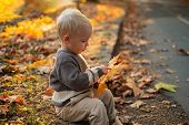 Kids Fashion. Happy Childhood. Childhood Memories. Child Autumn Leaves Background. Warm Moments Of A poster