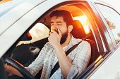 Tired Man Yawning While Driving His Car poster