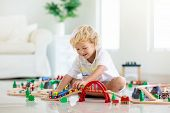 Kids Play Wooden Railway. Child With Toy Train. poster