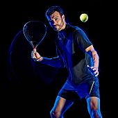 one caucasian Paddle tennis player man studio shot isolated on black background with light painting  poster