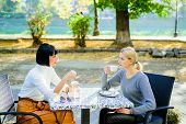 Friendship Meeting. Togetherness And Female Friendship. Conversation Of Two Women Cafe Terrace. True poster