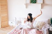 Dark Haired Beautiful Young Brunette Wake Up In Her Bed. Stretching Ahnd And Yawn. Alone In Bedroom. poster