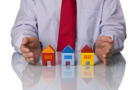 pic of real-estate agent  - Real estate agent showing houses isolated with reflection - JPG