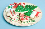 image of christmas cookie  - Plate full of christmas cookies over blue - JPG