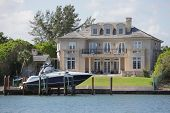 foto of dock a lake  - Stock image of a luxurious home with a boat - JPG