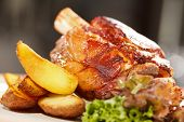 roasted pork knuckle with potatoes