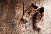 foto of hillbilly  - Old dirty brown leather shoes on wooden floor - JPG
