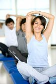 image of cardio exercise  - group of people at the gym smiling an doing stretching exercises - JPG